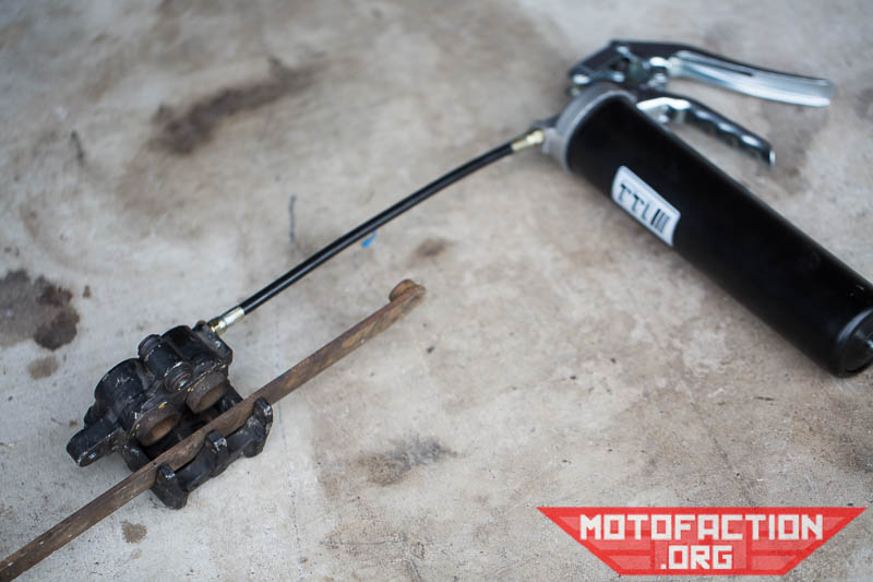How to remove stuck brake piston calipers with a grease gun