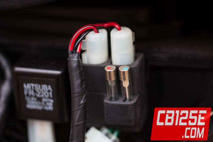 here are some photos showing how to check the secondary fuses on a honda  cb125e or